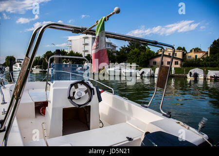 Cabin boat view with yachts, sailboats and boats moored at the dock in the background. Caorle - Italy - Stock Image