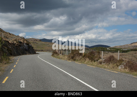 Lonesome Road #40. Remote road through the foothills of mountains - Stock Image