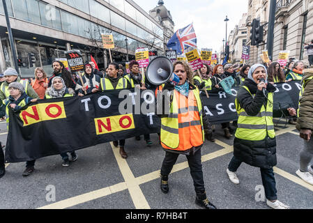 London, UK. 9th Dec, 2018. A united counter demonstration by anti-fascists marches on towards Whitehall.The protest was in opposition to Tommy Robinson's fascist pro-Brexit march. The march which included both remain and leave supporting anti-fascists gathered at the BBC to to to a rally at Downing St. Police had issued conditions on both events designed to keep the two groups well apart. Credit: Peter Marshall/Alamy Live News - Stock Image