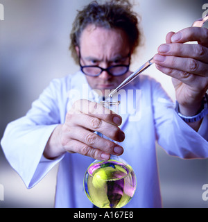 Scientific research. Man in labcoat and test-tube. - Stock Image