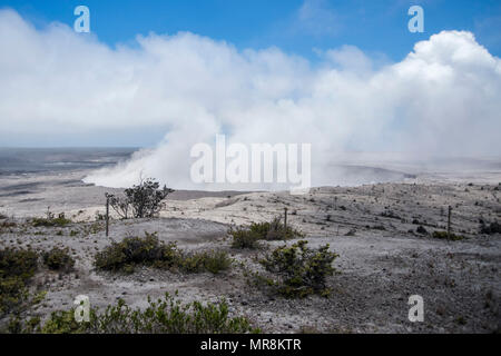 A poison gas cloud rises from the crater of the Kilauea volcano during the latest eruption May 22, 2018 in Pahoa, Hawaii. - Stock Image