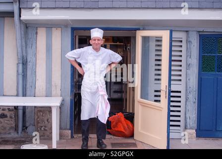 Happy cook posing - Stock Image