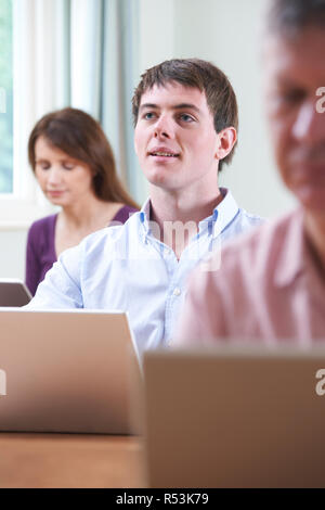 Young Man In Adult Education Class - Stock Image