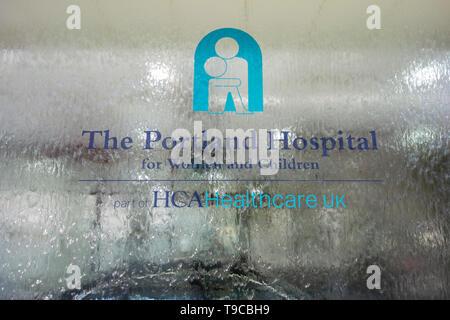 Entrance signage outside The Portland Hospital for Women and Children, HCA Healthcare, Great Portland Street, London, W1, UK - Stock Image