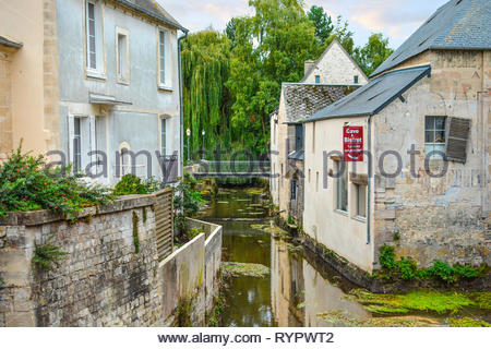 Picturesque buildings along the Aure river in the Normandy town of Bayeux France near the old mill - Stock Image