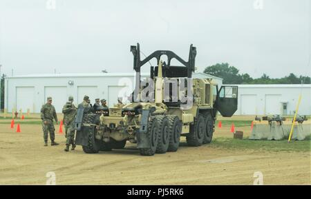 Soldiers at Fort McCoy, Wis., for training participate in a driver training session Aug. 24, 2018, at training area on the installation's cantonment area. The Soldiers were covering required training on a military vehicle they are required to use. During August 2018, thousands of service members were on post for training. (U.S. Army Photo by Scott T. Sturkol, Public Affairs Office, Fort McCoy, Wis.) - Stock Image