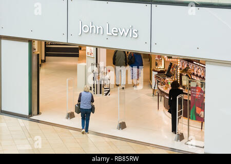 Interior Grand Arcade entrance to John Lewis with shoppers walking in the doorway, Cambridge, UK - Stock Image