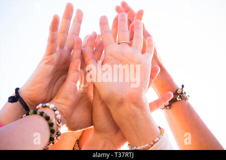 Group of many caucasian hands people together touching - cooperation and team people concept - clear white background and accessories - friendship and - Stock Image