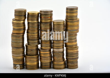 Heap of coins isolated on white background - Stock Image