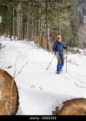 Girl snowshoeing in Black Forest, Germany, Europe - Stock Image