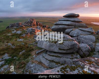 A view towards the setting sun from stones of Rough Tor in Bodmin, Cornwall - Stock Image