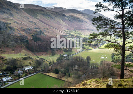 English lake district. A view of St. John in the Vale from High Rigg with the snowy ridge of Helvellyn in the distance. - Stock Image