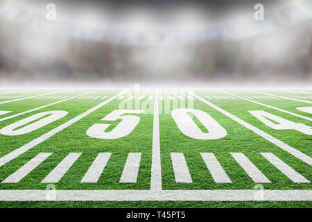 Close up of American football stadium field with yard line markings and spotlight with blurred background and copy space. - Stock Image
