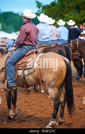 Cowboy members of PRCA riding horses  at rodeo event in Bridgeport, Texas, USA - Stock Image