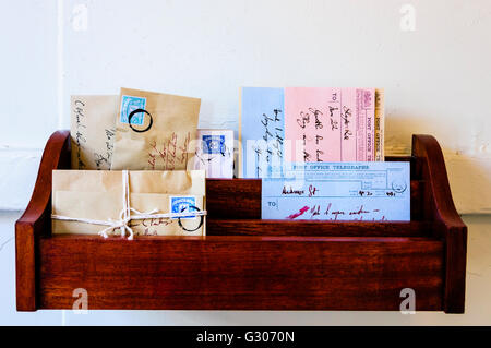 Letter rack from the early 1900s with a selection of letters and telegrams. - Stock Image