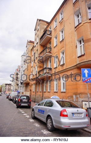 Poznan, Poland - March 8, 2019: Parked Skoda taxi car on special parking places on the Prusa street. - Stock Image