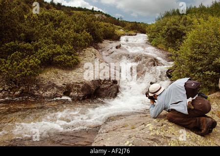 Nick Chaldakov take photography people in Rila mountain waterfall - Stock Image