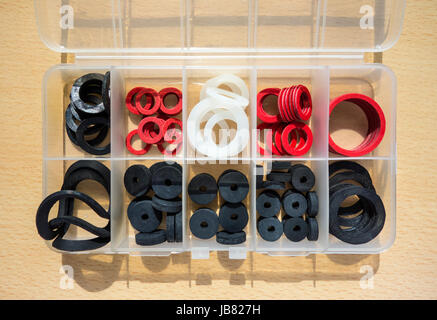 A handyman's box of assorted washers of all types and sizes - Stock Image