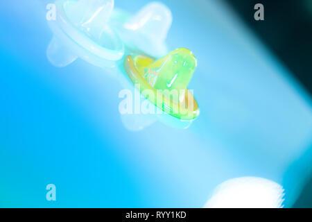 Rubber latex condom male contraceptive for safe disease and pregnancy free sex. - Stock Image