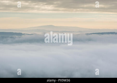 Titterstone Clee Hill above the mist in Ape Dale, seen from Ragleth Hill, Church Stretton, Shropshire - Stock Image