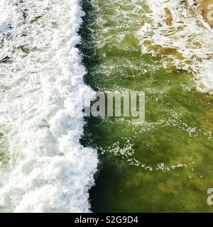 Whitewater from a breaking wave from above. Manhattan Beach, California USA. - Stock Image