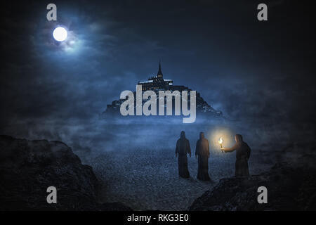 Three monks are going to the abbey Mont Saint Michel under the night sky with big moon. Matte painting. - Stock Image