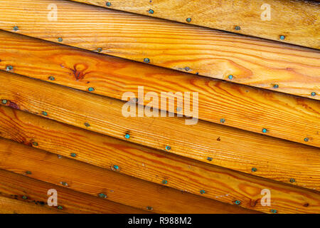 close up of clinker built wooden hull. - Stock Image