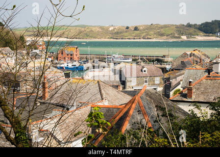 Looking down over the rooftops of Padstow towards the harbour and estuary. - Stock Image