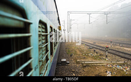 View through the window train in the polluted city of New Delhi, India. - Stock Image