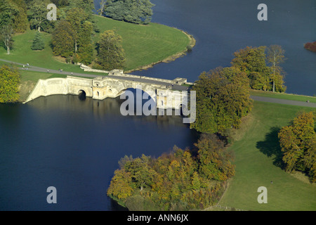 Aerial view of the Grand Bridge at Blenheim Palace spanning the lake near Woodstock in Oxfordshire - Stock Image