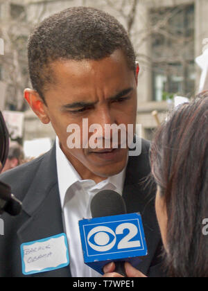 Illinois State Senator Barack Obama interviewed at anti war protest. Chicago 3-16-2003. Note name tag. - Stock Image