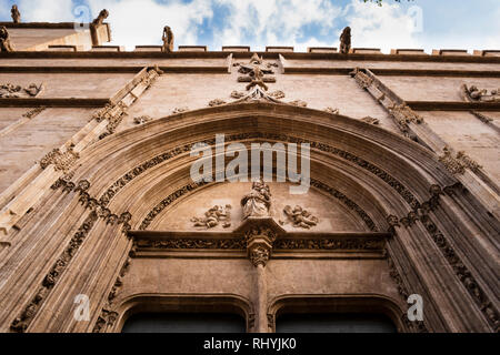 Decorative arched doorway entrance and gargoyles to the Silk Exchange in Valencia Spain - Stock Image