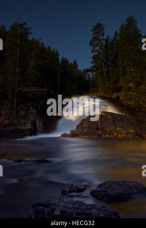 Waterfall in night landscape - Stock Image