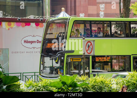 People riding on a Singapore SG Bus. More than 576 scheduled bus services operate in and around Singapore via a number of service providers. - Stock Image