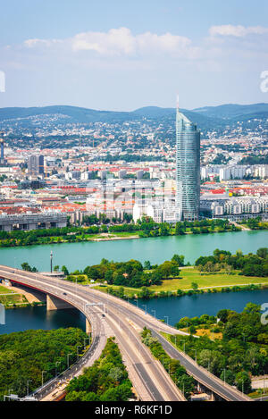 Long highway over the river leading to the business city center - Stock Image