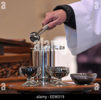 The Reverend Frank Carter blesses the ashes during Ash Wednesday services at St. Bernadette's Church in New - Stock Image