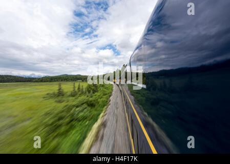 Alaska Railways train through forest Seward, Alaska - Stock Image