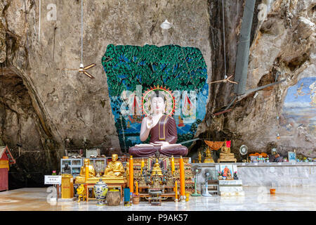 KRABI, THAILAND - APRIL 10: Buddha images in the Tiger Cave Temple on April 10, 2016 in Krabi, Thailand. - Stock Image