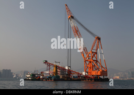 pipe laying and dredging dredger hong kong harbour - Stock Image