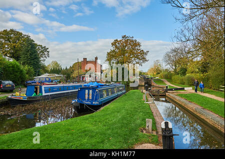 Canal narrowboats moored in a side pound adjacent to locks on the Stratford upon Avon canal, Lapworth, Warwickshire - Stock Image