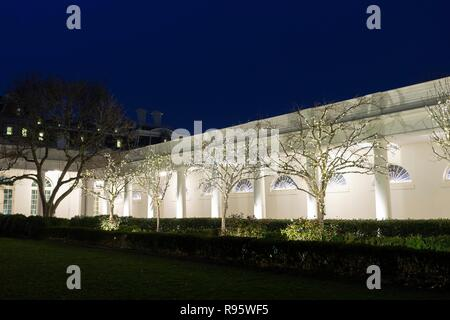 The west wing colonnade of the White House decorated for Christmas and lighted at night December 12, 2018 in Washington, DC. - Stock Image