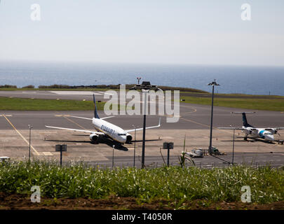 Two planes sit on the apron of the Nordela Airport in São Miguel, The Azores - Stock Image