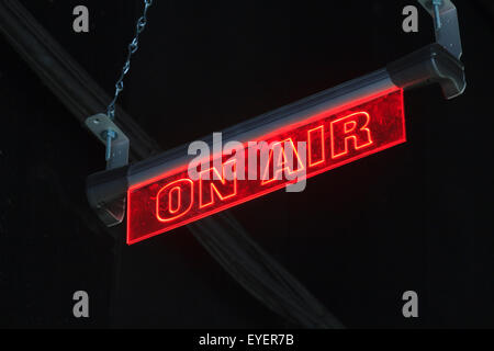Television studio red 'on air' sign lit up - Stock Image