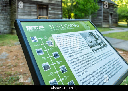 1830s Slave cabins from the Mount Pleasant Plantation in Covington, Georgia are preserved at Historic Square in Atlanta's Stone Mountain Park. (USA) - Stock Image