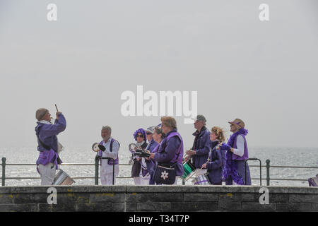 Penzance, Cornwall, UK. 6th Apr, 2019. UK Weather. It was a warm sunny afternoon at Penzance. 'Penzamba' brought a touch of the tropical to Cornwall as they practiced their samba music on the seafront at lunchtime. Credit: Simon Maycock/Alamy Live News - Stock Image