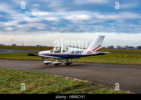 G-OFIT, a TB10 Socata Tobago taxiing at Biggin Hill Airport - Stock Image