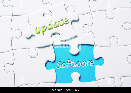 The Words Update And Software In Missing Piece Jigsaw Puzzle - Stock Image