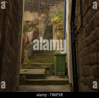 Stepped alleyway between village houses in Staithes, East Yorkshire, UK - Stock Image