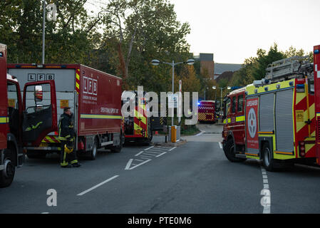London, United Kingdom. 9 October 2018. Ten fire engines and around 70 firefighters were called to a fire at a student accommodation block at Brunel University London in Kingston Lane in Uxbridge. The Brigade was called at 16:07BST. Fire crews from Hillingdon, Hayes, Southall, Northolt, Ruislip and other surrounding fire stations are at the scene. Firefighters also utilised a drone, which is currently being trialed, to survey the area. Credit: Peter Manning/Alamy Live News - Stock Image