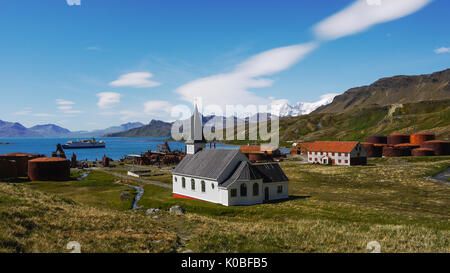 Old abandoned Norwegian whaling station and settlement of Grytviken with restored Lutheran Whalers Church.South Georgia Island. Antarctic cruise ship. - Stock Image